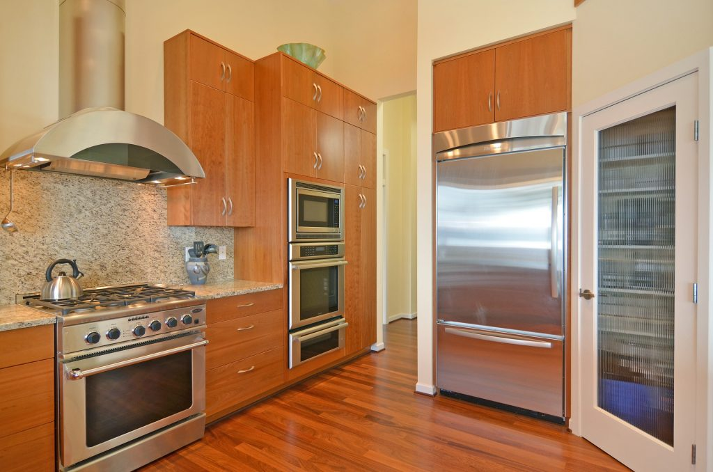 A kitchen with a walk in freezer