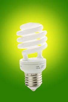 light bulb with green background making homes more energy efficient